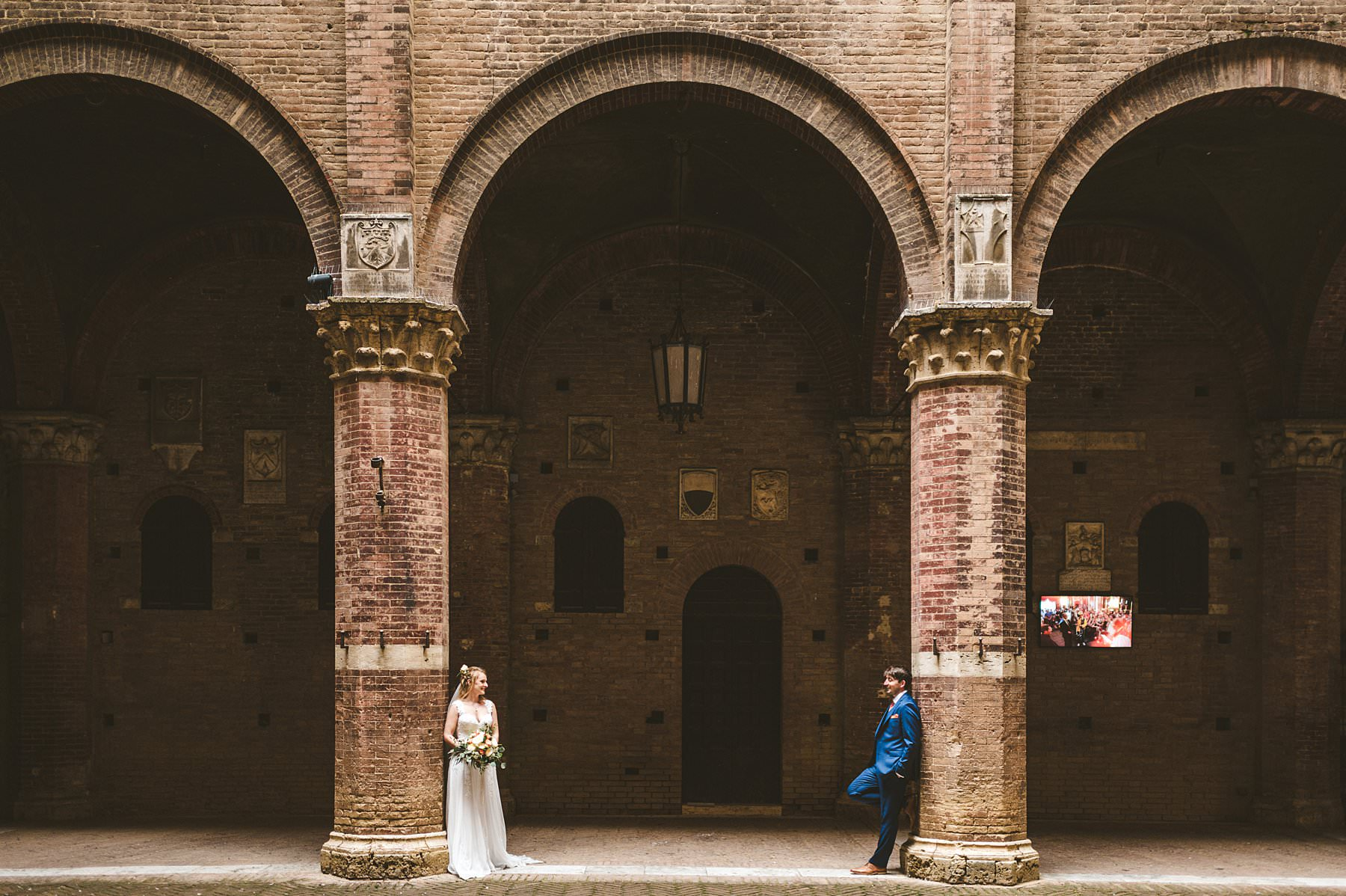 Lovely bride and groom elopement wedding photo at Siena Town Hall in the heart of the city