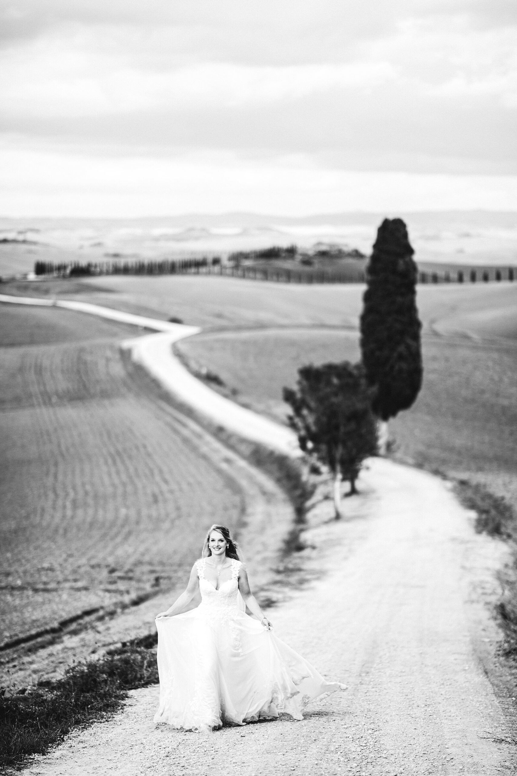 Gorgeous bride walks in Justine Alexander gown at the evocative and iconic countryside of Tuscany