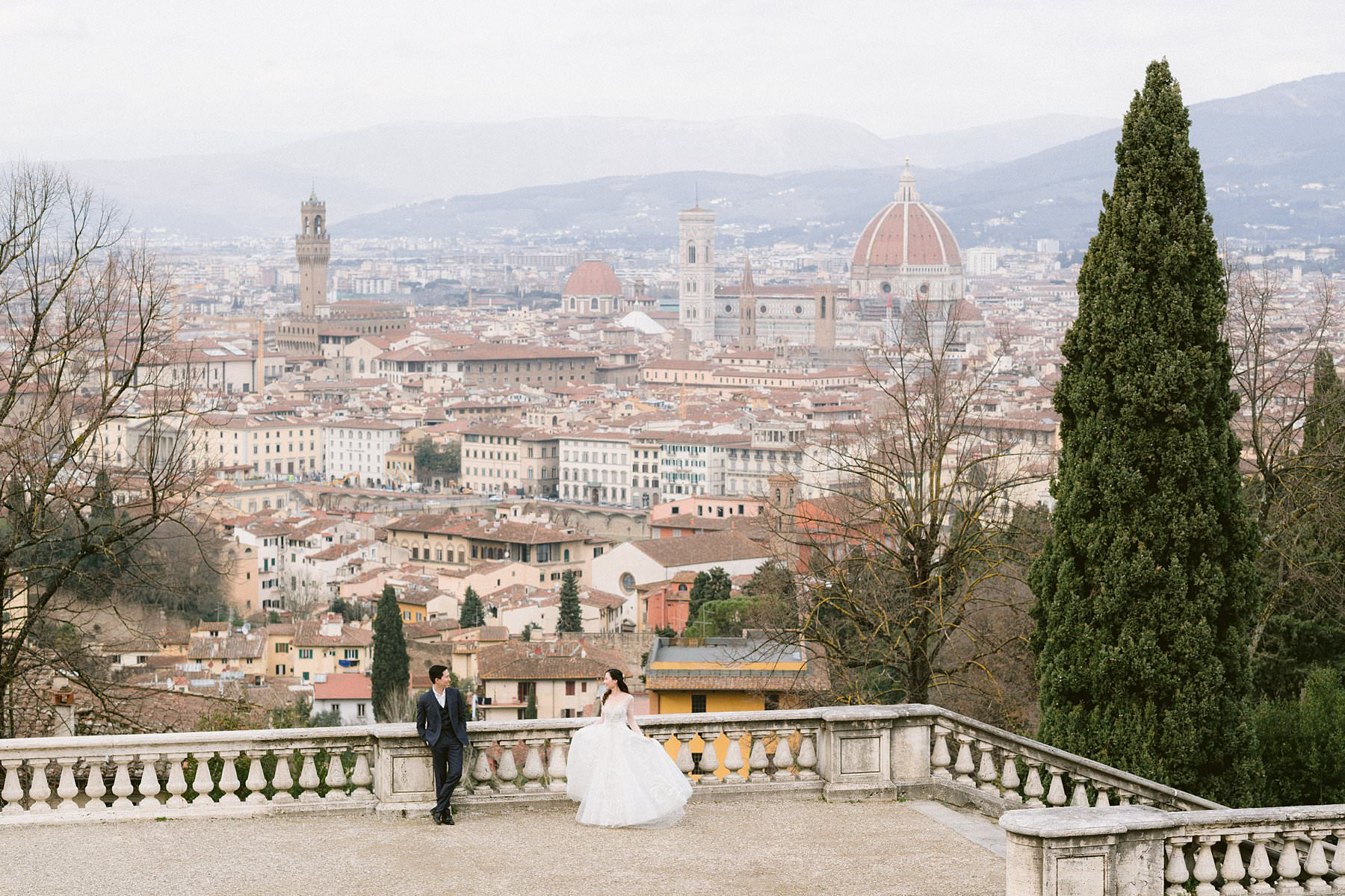 Romantic couple photos for a special honeymoon in Florence at San Miniato al Monte the best panoramic spot in the city