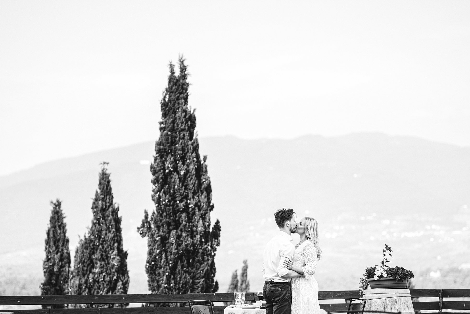 Surprise proposal photo shoot during dinner time at Poggio Tre Lune's panoramic view top terrace