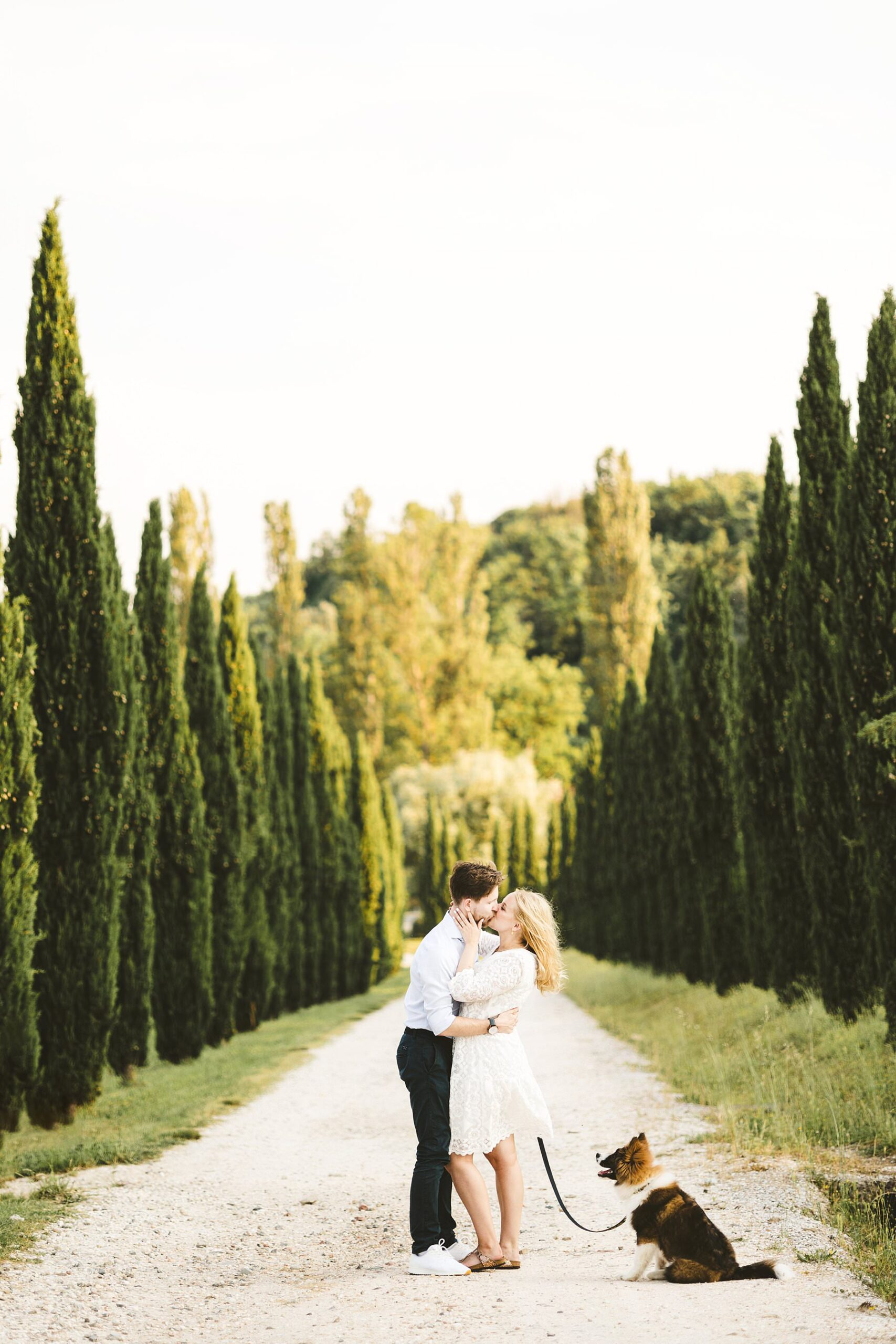 A truly unforgettable proposal photoshoot in Tuscany with evocative cypresses street at Poggio Tre Lune