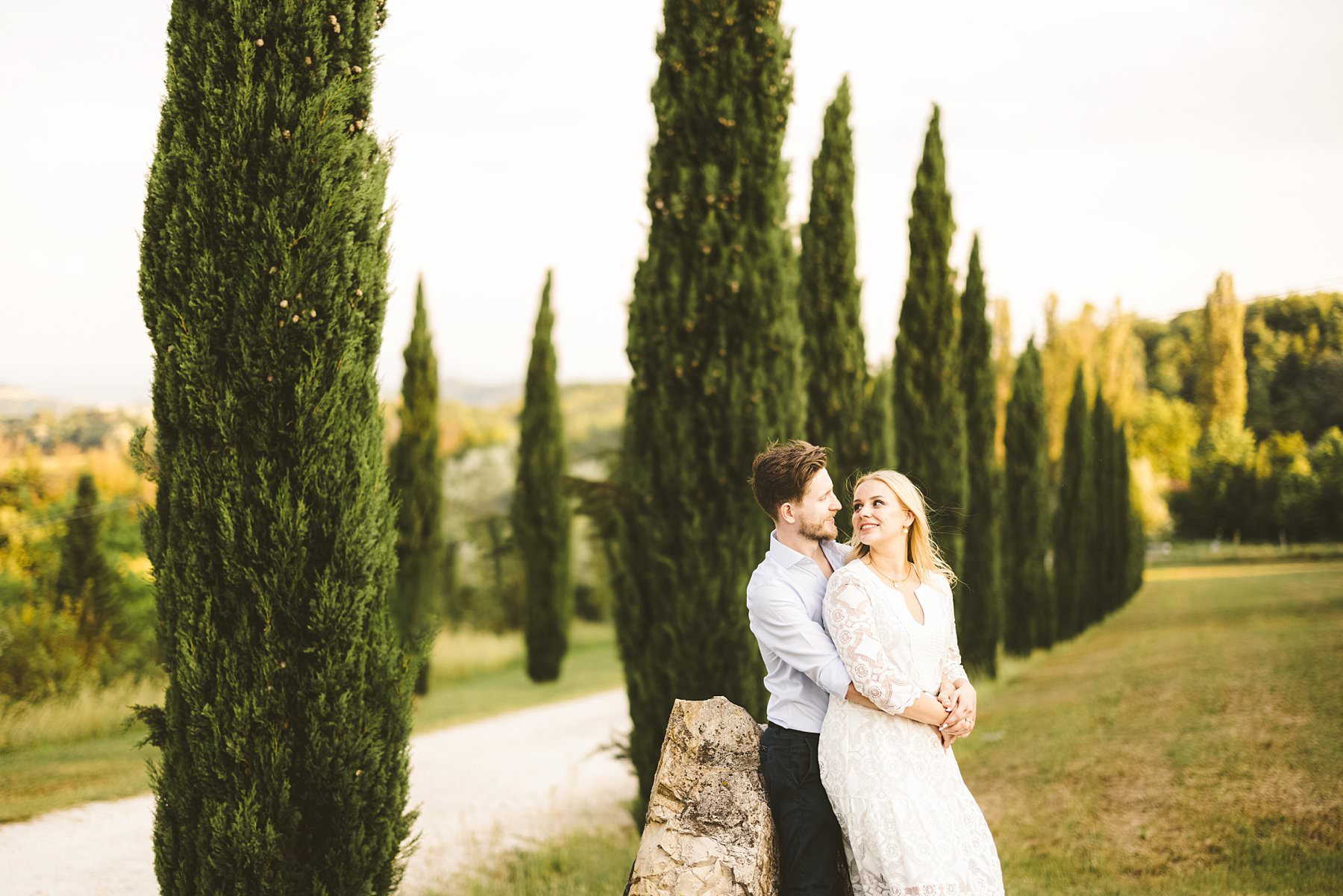 Engagement in a Tuscan cypresses street is a must. Poggio Tre Lune located in the countryside of Florence is a perfect venue to host a couple shoot with a lot of beautiful spots